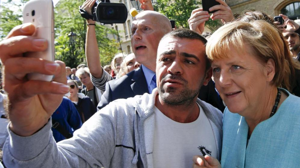 Merkel con refugiados