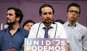 Podemos (We Can) party leader Pablo Iglesias (C), now running under the coalition Unidos Podemos (Together We Can), gives remarks on results in Spain's general election in Madrid, Spain, June 26, 2016. REUTERS/Andrea Comas